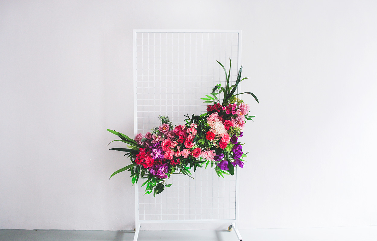 grid mesh floral backdrop photo booth rental telltale